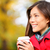 young woman drinking coffee in autumn fall stock photo © maridav