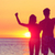 happy fitness people on beach at sunset flexing stock photo © maridav