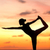yoga woman in serene sunset at beach doing pose stock photo © maridav