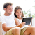 couple relaxing together in sofa with tablet pc stock photo © maridav