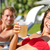 people drinking beer at relaxing at beach resort stock photo © maridav