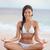 meditáció · jóga · nő · tengerpart · meditál · óceán - stock fotó © maridav