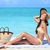 Beach bikini woman sun tanning on summer vacation stock photo © Maridav