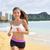 running sport fitness woman jogging on beach run stock photo © maridav