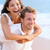 happy couple piggybacking on beach stock photo © maridav