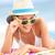 Woman on beach with sunglasses stock photo © Maridav
