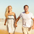 Beach couple holding hands running having fun stock photo © Maridav
