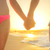 Love - romantic couple holding hands, beach sunset stock photo © Maridav