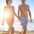 Attractive young couple walking on tropical beach stock photo © Maridav