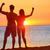 sporty fitness couple cheering at beach sunset stock photo © maridav