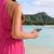 smart phone woman using smartphone app on beach stock photo © maridav