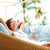 kadın · genç · kız · oturma · veranda · gülümseyen · kadın · gülen - stok fotoğraf © maridav