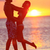 romantic couple kissing on beach sunset on travel stock photo © maridav