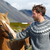 icelandic horses   man petting horse on iceland stock photo © maridav