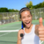 tennis player woman giving thumbs up happy excited stock photo © maridav
