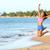 excited woman jumping at beach   fitness girl stock photo © maridav