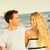 Beach couple laughing walking at romantic sunset stock photo © Maridav