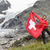 switzerland hiker cheering showing swiss flag stock photo © maridav