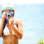 summer beach woman holding camera taking picture stock photo © maridav