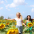 two young women running through sunflowers stock photo © maridav