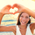 love vacation   woman showing heart on beach stock photo © maridav