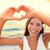 mulher · jovem · coração · assinar · brilhante · quadro - foto stock © maridav