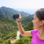 girl taking smartphone picture of mountain nature stock photo © maridav