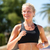 female runner running listening smartphone music stock photo © maridav