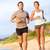 running young couple jogging in beach sand happy stock photo © maridav