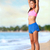 smiling woman doing stretching exercise on beach stock photo © maridav