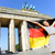 german flag woman joy at berlin brandenburger tor stock photo © maridav