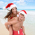 christmas couple having fun on beach vacation stock photo © maridav