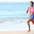 corrida · determinado · mulher · corredor · corrida · praia - foto stock © Maridav