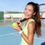 happy girl with racquet and ball on tennis court stock photo © maridav