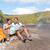 couple hiking on volcano on hawaii looking at map stock photo © maridav