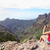 woman photographing mountains on travel stock photo © maridav