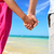 Holding hands romantic newlyweds couple on beach stock photo © Maridav