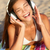 woman listening to music with headphones at beach stock photo © maridav