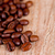 fresh coffee beans on rustic wooden board stock photo © marylooo