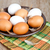 eggs in a plate towel and feathers stock photo © marylooo