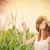 mulher · jovem · em · pé · campo · sorridente · flores - foto stock © massonforstock