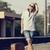 hipster girl at railways platform stock photo © massonforstock
