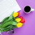 cup of coffee and tulips with notebook stock photo © massonforstock