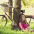 beautiful girl sitting near bike and tree at rest in forest pho stock photo © massonforstock