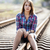 sad teen girl sitting at railway stock photo © massonforstock