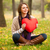 Girl with toy heart at autumn park. stock photo © Massonforstock