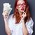 Portrait of a businesswomen in white shirt with money stock photo © Massonforstock