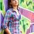 style teen girl standing near graffiti wall stock photo © massonforstock