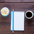 photo of notebook with pencil cup of coffee and cupcake on the stock photo © massonforstock