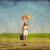 vörös · hajú · nő · esernyő · bőrönd · tavasz · mező · fotó - stock fotó © massonforstock